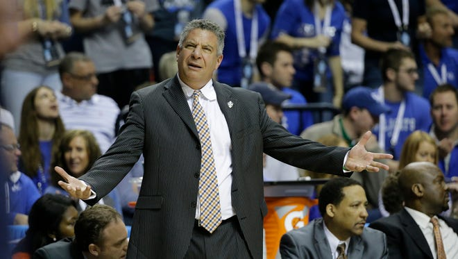 Auburn head coach Bruce Pearl calls a play against Kentucky during the first half of an NCAA college basketball game in the semifinal round of the Southeastern Conference tournament, Saturday, March 14, 2015, in Nashville, Tenn. (AP Photo/Mark Humphrey)