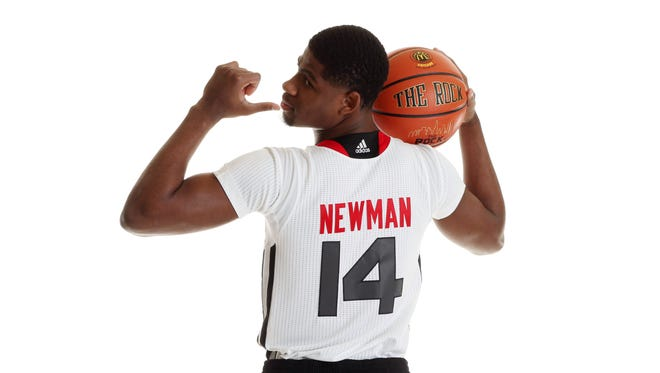McDonalds High School All American athlete Malik Newman (14) poses for pictures during portrait day at the Westin Hotel.
