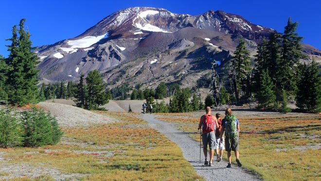 Hikers follow a trail, beginning at Devil's Lake Trailhead outside Bend, to the summit of South Sister.