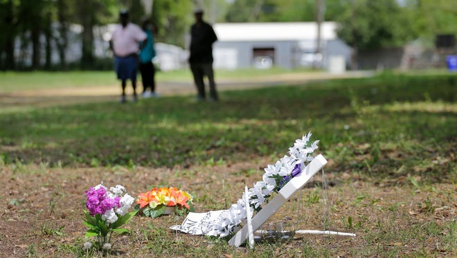 A memorial and flowers are placed near the site where Walter Scott was killed in North Charleston, S.C., Wednesday, April 8, 2015.