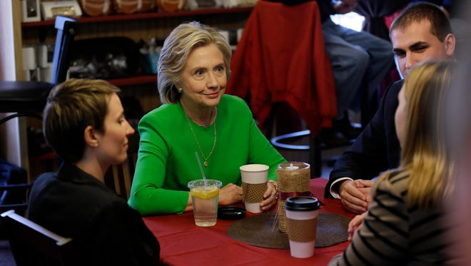 Democratic presidential candidate Hillary Clinton meets with patrons at the Jones St. Java House, Tuesday, April 14, 2015, in LeClaire.
