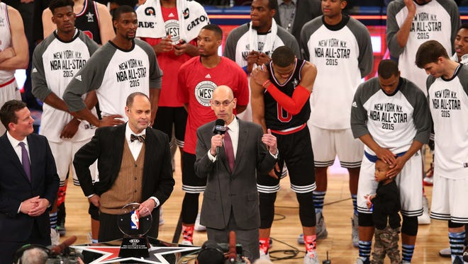NBA commissioner Adam Silver presenting MVP after the second half of the 2015 NBA All-Star Game at Madison Square Garden.