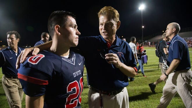Peoria Centennial coach Richard Taylor talks to Isaac Haney after beating Phoenix Brophy Prep on Sept. 11, 2014.