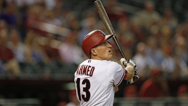 Diamondbacks' Nick Ahmed (13) hits a ball against the Rockies at Chase Field in Phoenix on April 27, 2015.