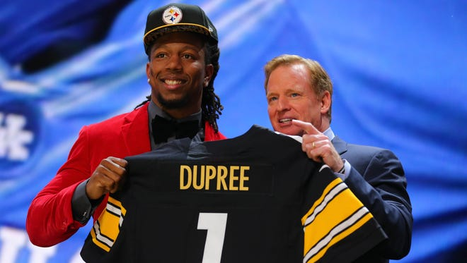 Bud Dupree (Kentucky) poses for a photo with NFL commissioner Roger Goodell after being selected as the 22nd overall pick to the Pittsburgh Steelers in the first round of the 2015 NFL Draft at the Auditorium Theatre of Roosevelt University.