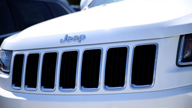 MIAMI, FL - APRIL 02:  A 2014 Jeep Cherokee is seen on a sales lot on April 2, 2014 in Miami, Florida.  Chrysler Group LLC announced it is recalling 867,795 Jeep Grand Cherokee and Dodge Durango sport-utility vehicles to install a shield to protect brake boosters from water corrosion.  (Photo by Joe Raedle/Getty Images)