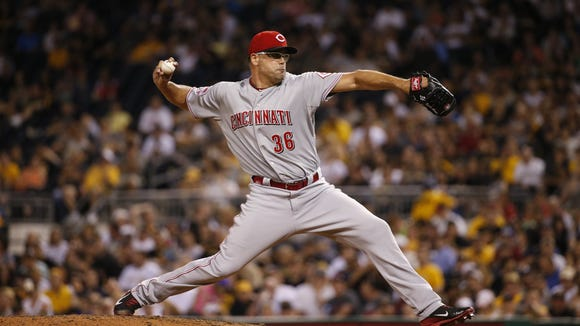 Reds relief pitcher Kevin Gregg throws in the seventh