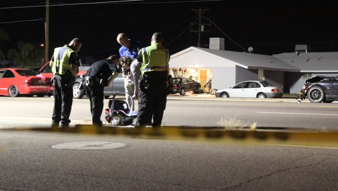 Investigators at the scene of a crash in Glendale that critically injured a 3-month-old baby.