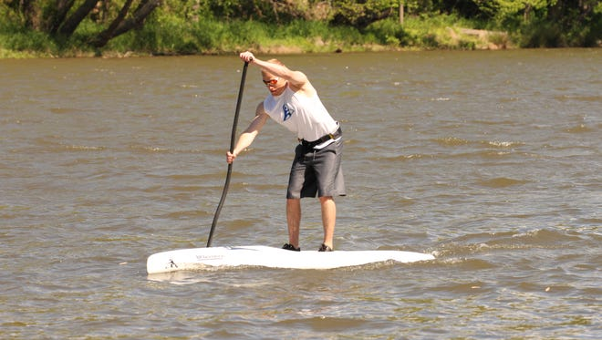 Asheville paddler Chris Gragtmans trains for the inaugural Battle of the Broad SUP race this weekend on the French Broad River.