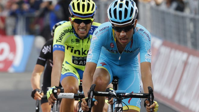 Astana's Fabio Aru (R) and Spain's Alberto Contador (C) cross the finish line of the fifth stage of the Giro d'Italia on May 13.