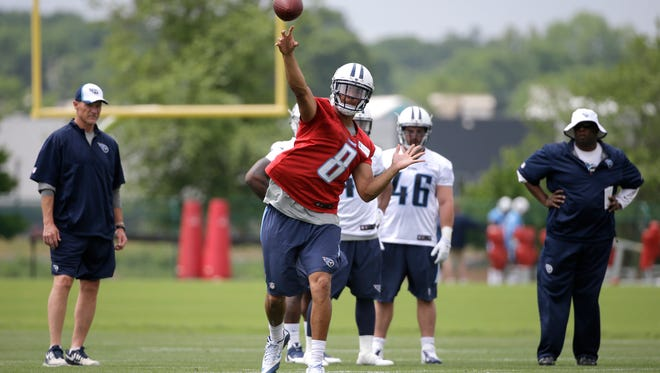 Tennessee Titans quarterback Marcus Mariota (8) passes during a rookie minicamp practice Friday, May 15, 2015, in Nashville, Tenn. (AP Photo/Mark Humphrey)