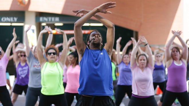 YMCA Instructor Andre Davis teaches a hip hop exercise class for  Workout Wednesday class on Georgia St.