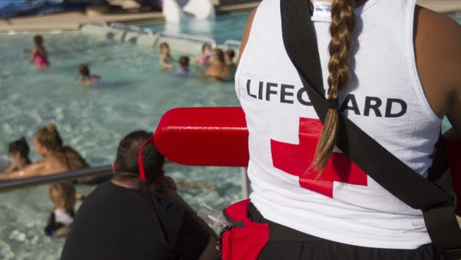 Lifeguard Taylor Martinez, 17, stands guard over the swim lessons at Sunrise Pool, Wednesday, April 15th, 2015, in Peoria, Ariz.
