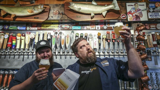Alex Rowan, a certified beer server at El Bait Shop and Jeff Bruning, beer expert and owner of El Bait Shop discuss beer with a brew in hand on Thursday, May 21, 2015 in Des Moines.