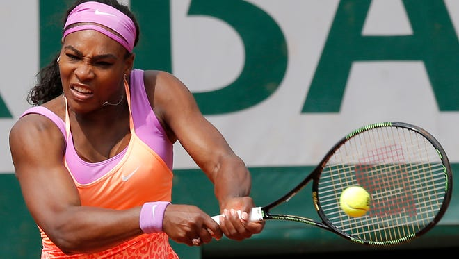 Serena Williams returns the ball to Germany's Anna-Lena Friedsam during their second round match of the French Open tennis tournament at the Roland Garros stadium, on May 28, 2015.
