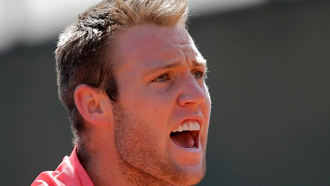 Jack Sock of the U.S. screams after scoring a point in the third round match of the French Open against Croatia's Borna Coric at the Roland Garros stadium, in Paris, May 30, 2015.