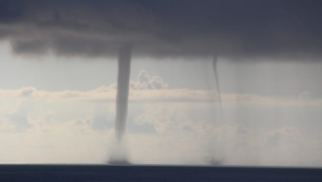 A pair of early morning waterspouts was caught on camera at Cocoa Beach. The 2015 El Niño weather pattern increases Florida's chance of seeing severe weather.