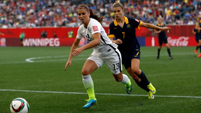 Jun 8, 2015; Winnipeg, Manitoba, CAN; United States forward Alex Morgan (13) and Australia defender Steph Catley (7) chase the ball in a Group D soccer match in the 2015 women's World Cup at Winnipeg Stadium. Mandatory Credit: USA TODAY Sports Images