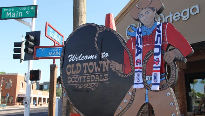 The Scottsdale Cowboy is decked out with a scarf in honor of the Women's World Cup