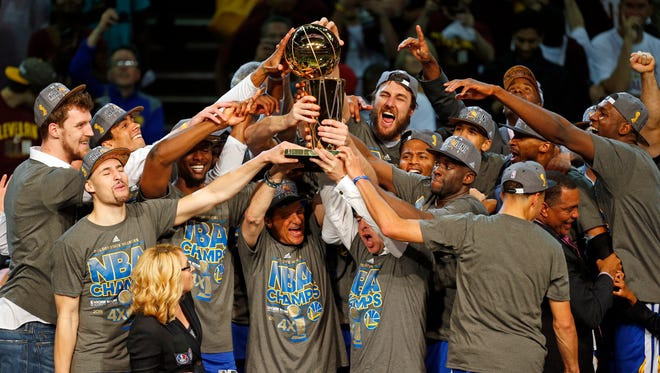 The members of the Golden State Warriors celebrate after winning the NBA Finals against the Cleveland Cavaliers in Cleveland, Wednesday, June 17, 2015. The Warriors defeated the Cavaliers 105-97 to win the best-of-seven game series 4-2. (AP Photo/Paul Sancya)