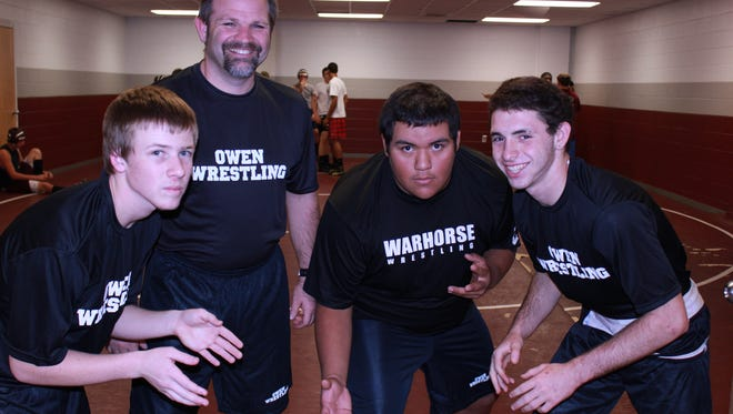 Former Owen wrestling coach Jeff Foster had been with the Warhorses for seven years.