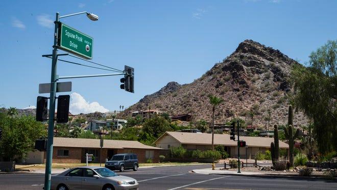 Roadway signs of Squaw Peak Drive near Piestewa Peak in Phoenix..