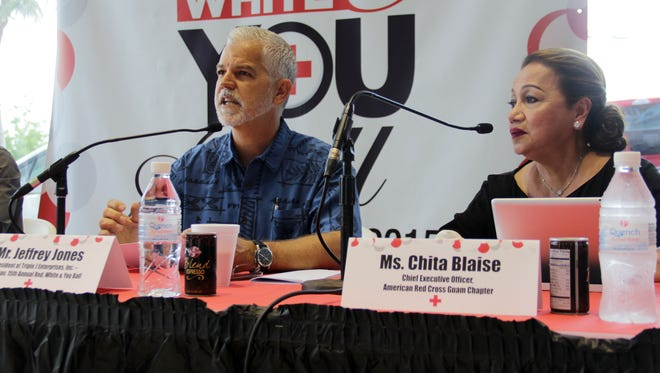 Triple J Enterprises President Jeffrey Jones, left, sits next to American Red Cross Guam CEO Chita Blaise and talks about why he wants to get involved with the local chapter's 15th Annual Red Ball. The two spoke at a press conference for the ball held July 16 at Triple J Auto Group's main location in Upper Tumon.  The Red Ball is a black-tie fundraising event that has historically raised the most funds for the Guam chapter each year.