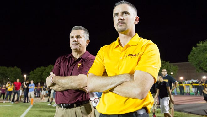 Todd Graham (left) and Mike Norvell watch Mountain Pointe take on Chandler on Friday, Sept. 19, 2014 in Phoenix.