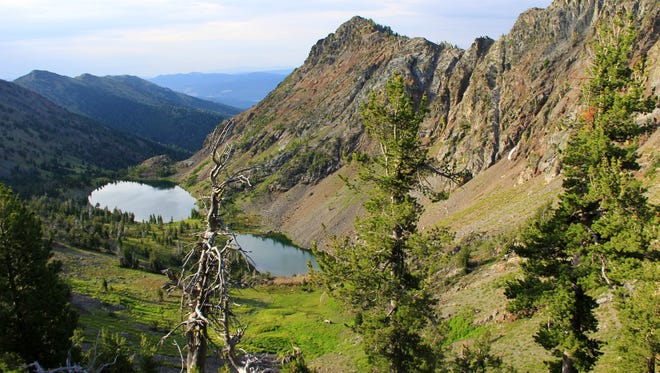 The Twin Lakes Basin shimmers below the Elkhorn Crest Trail in Eastern Oregon.