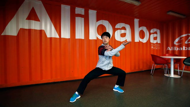 A worker demonstrates martial arts during an open day at the Alibaba Group office in Hangzhou in east China's Zhejiang province in 2013.