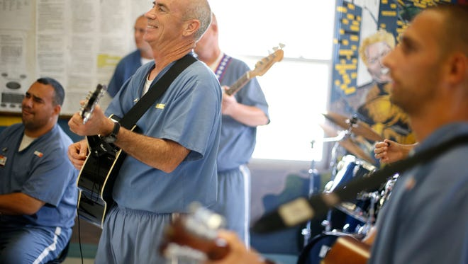 Inmates at the Wakulla Work Camp Correctional Institution perform together in their group called the Behind the Wire Choir.
