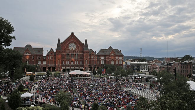 Attendees file into Washington Park for Lumenocity at Music Hall Wednesday.