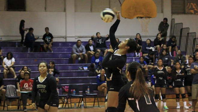 John F. Kennedy Islanders' Narissa Blas (11) spikes the ball against the St. Paul Warriors during the 16th Annual Shieh High School Invitational Volleyball Tournament game at the George Washington High School Gym in Mangilao on Aug. 16.