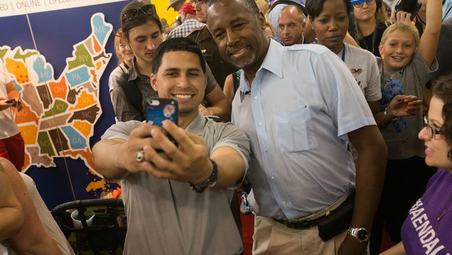 Republican presidential candidate, Dr. Ben Carson, greets fairgoers as he tours the Iowa State Fair in Des Moines, Iowa, Sunday, Aug. 16, 2015.