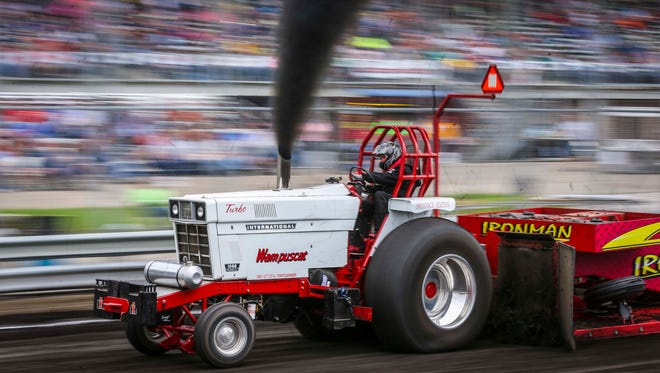 Wampuscat competes at the Grand Outlaw National Tractor and Truck Pull at the Grandstand of the Iowa State Fair Wed. Aug. 19, 2015, in Des Moines, Iowa.