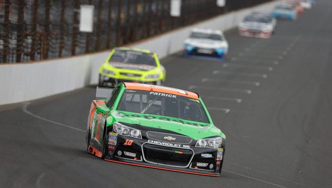 Danica Patrick heads into the first turn during the Brickyard 400 at Indianapolis Motor Speedway.