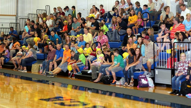 Students and parents watch Ankeny Christian Academy's orientation assembly Thursday evening.