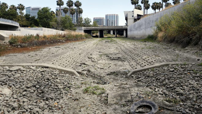 The dried up bed of the Guadalupe River in San Jose, Calif., on July 17, 2015.
