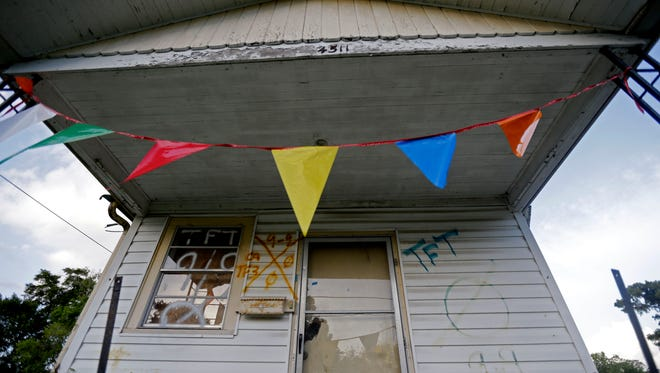 An abandoned home destroyed by Hurricane Katrina sits in a residential section of New Orleans East, Thursday, Aug. 6, 2015. A decade ago, polluted water up to 20 feet deep flooded 80 percent of the city. Katrina killed more than 1,500 people in Louisiana, many of them drowning inside their homes, and hundreds more simply disappeared, the National Hurricane Center reported a year later.