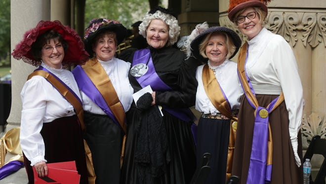 Dressed as Sufferagettes, left to right, Nancy Papas, Sara Walling, Jamia Jacobsen, Marilyn Updike, Susan Steva, pose for a photo at the She Votes party, celebrating the 95th anniversary of women's suffrage, hosted by the Propylaeum Historic Foundation, Wednesday August 26th, 2015.