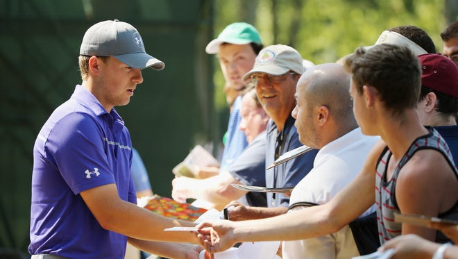 Jordan Spieth signs autographs for fans during a practice round prior to the start of The Barclays at Plainfield Country Club on Aug. 26, 2015 in Edison, New Jersey.