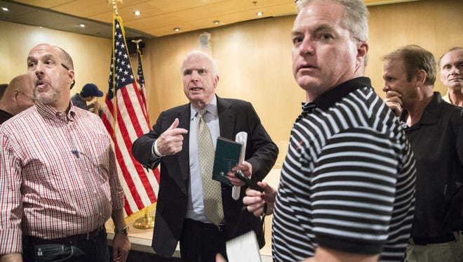 U.S. Sen. John McCain, R-Ariz., provided an update on congressional efforts to reform the Department of Veterans Affairs during a town hall with veterans at the Burton Barr Central Library in Phoenix on Thursday, Aug. 27, 2015.