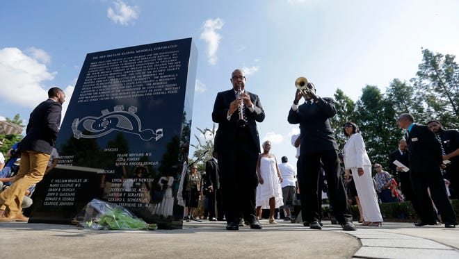 Musicians lead the procession during a wreath-laying ceremony at the Hurricane Katrina Memorial, on the 10th anniversary of the devastating storm in New Orleans on Aug. 29, 2015.
