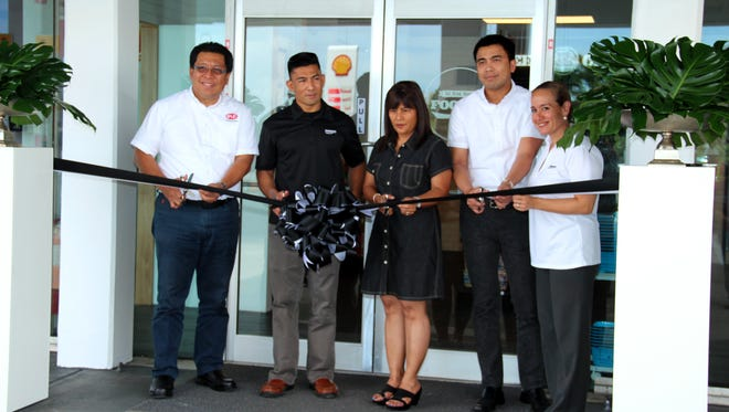 """IP&E celebrated the opening of its second Foody's location Thursday morning at the Barrigada Shell service station.  From left, Richard Behag, IP&E director of supply, distribution, HSSE and engineering; Brian Bamba, IP&E managing director; Barrigada mayor June U. Blas; Tristan Dumlao, Prospector Investments group chief operations officer and Pinki Lujan, Foody's station manager. """"We launched Foody's a year ago at our Micro Mall station, and our customers told us that they wanted more,"""" Bamba stated."""