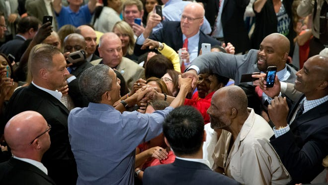 President Barack Obama greets members of the crowd after speaking at the Greater Boston Labor Council Labor Day Breakfast, Monday, Sept. 7, 2015, in Boson. Obama will sign an Executive Order requiring federal contractors to offer their employees up to seven days of paid sick leave per year. (AP Photo/Andrew Harnik)