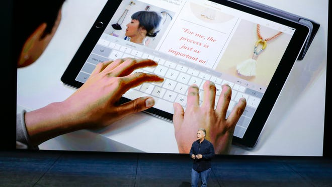Phil Schiller, Apple's senior vice president of worldwide marketing, introduces the new iPad Pro at the Apple event in the Bill Graham Civic Auditorium in San Francisco, Wednesday, Sept. 9, 2015. (AP Photo/Eric Risberg)