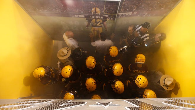 The Sun Devils prepare to take the field to play Cal Poly at Sun Devil Stadium on Sep. 12, 2015 in Tempe.