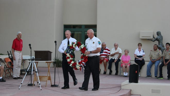 MPD Deputy Chief Scott Taylor, left, and MFD Chief Kash Christopher lay a wreath down at the 9/11 ceremony.