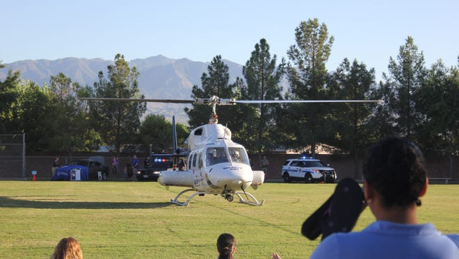 The Mercy Air helicopter lands on the field at a previous Mesquite Night Out.