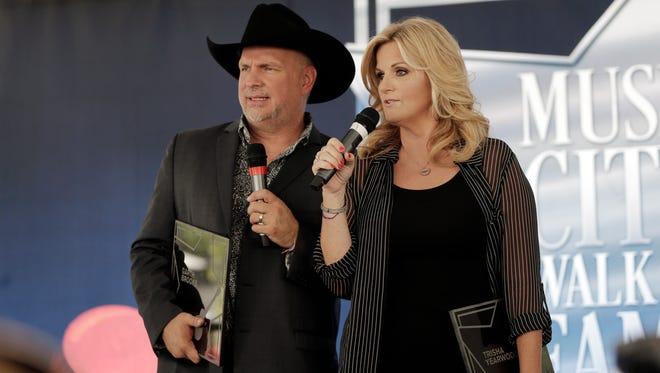 Garth Brooks and Trisha Yearwood speak after receiving stars on the Music City Walk of Fame on Thursday, Sept. 10, 2015, in Nashville, Tenn.